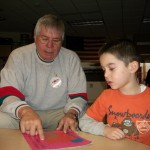 America Reads volunteer Bill Pember working with an elementary student to develop reading skills.